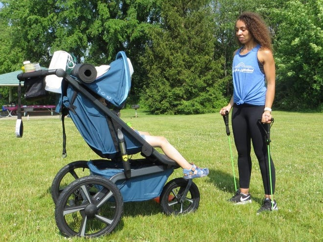 Kyria Phenix leads a stroller class through Fit4Mom Holland during the organization's grand reopening Saturday, June 12.