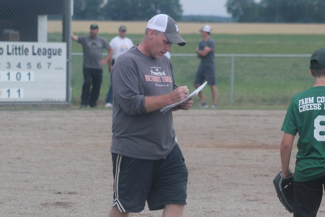 Corey Smith coaches his fifth/sixth grade little league team Wednesday, June 23, at Blossom Time Park in Pewamo. Wednesday marked Smith's final game as Pewamo Little League commissioner, a position he has served for 15 years.