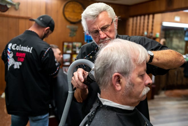 John Bargar cuts Steve Englebrecht's hair at Colonial Barbershop in Pekin on Thursday, June 24, 2021. Bargar, who has owned and operated the barbershop for 54 years, says he still loves the work.