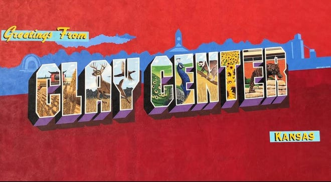"""Clay Center has launched a mural project. An  early mural resembles a giant postcard with the message """"Greetings from Clay Center."""""""