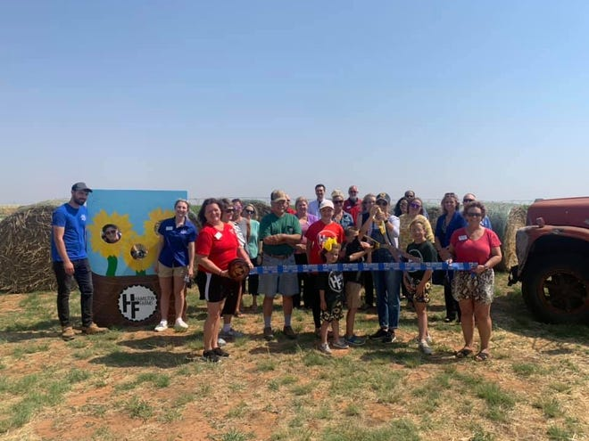 Hamilton Farms Sunflower Days, 6830 FM 1729 Shallowater. Holding scissors is owner Kyla Hamilton. Holding ribbon are Chamber Ambassadors Jada Morrow, left, and Tracy Polk. Others pictured are Gary and Suzanne Hamilton; Clara, Hannah, Collier and Hunter Hamilton; staff, friends and other Lubbock Chamber Ambassadors.