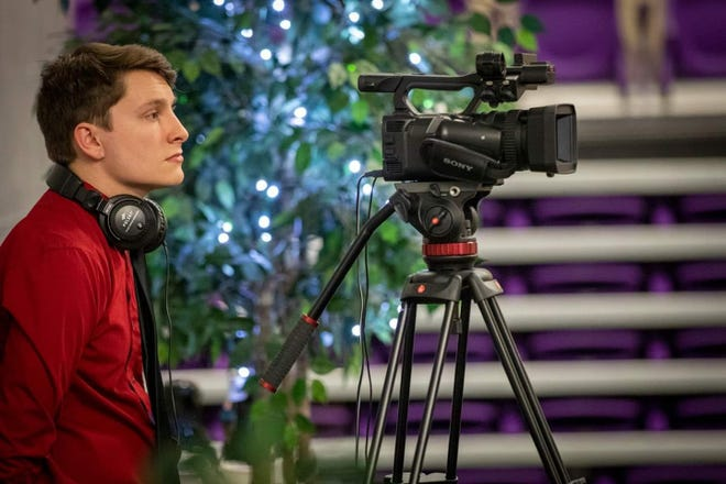 LCHS grad Zak Luken working behind the scenes at a Lincoln College event.