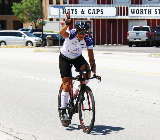 """A cyclist with """"The Opportunists"""" makes his way through Camdenton on June 22. The 4-person team from West Palm Bleach, Fla., is racing to support Opportunity Inc., a non-profit early childhood education and family center in West Palm Beach."""