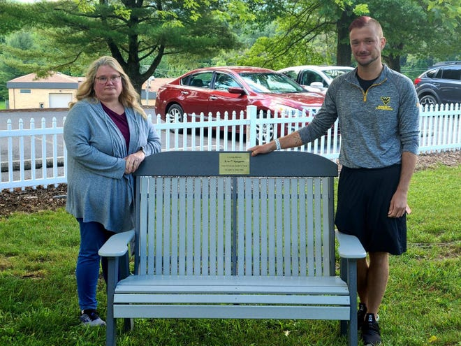Wendy Sgaggero (left) and Seth Sgaggero with the bench they donated to the Potomac Center in Brian Sgaggero's honor.