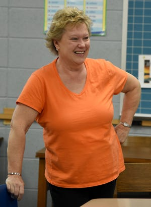 Kathy Kuhlman holds back tears as a tribute was broadcasted over the loudspeakers inside Summerfield Jr/Senior High School. Kuhlman has retired after a 36-year career as a special education teacher in the district.