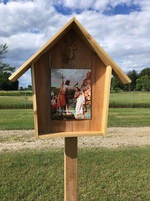 Students from Lincoln Park High School built the cedar shrines for the Rosary Garden.