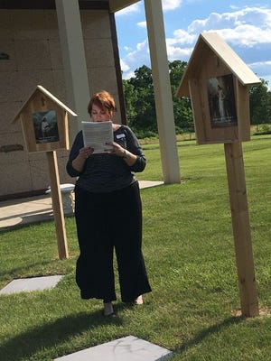 Rachel Lazere from St. Joseph Cemetery led Tuesday night's Rosary Garden Walk.