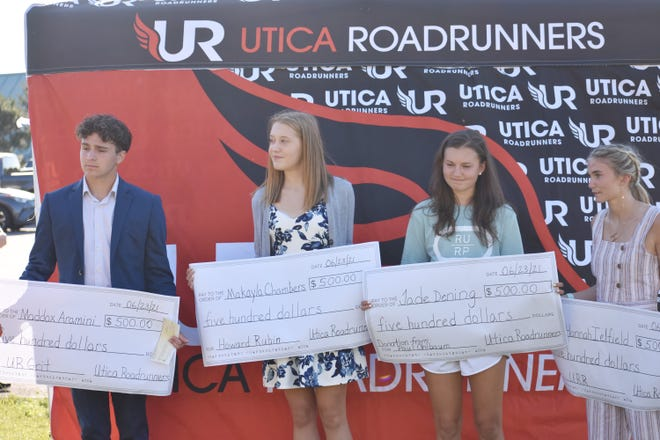 From left, Maddox Aramini, Makayla Chambers, Jade Dening and Hannah Iefield listen during a presentation in which they were awarded scholarships by the Utica Roadrunners group on Wednesday, June 23, 2021 at Utica Parkway.