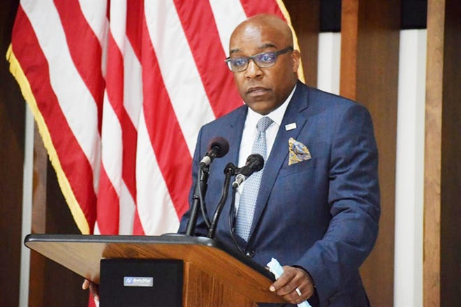 Illinois Attorney General Kwame Raoul speaks at a press conference recently. Raoul filed a lawsuit over claims of illegal pollution at a former coal plant.