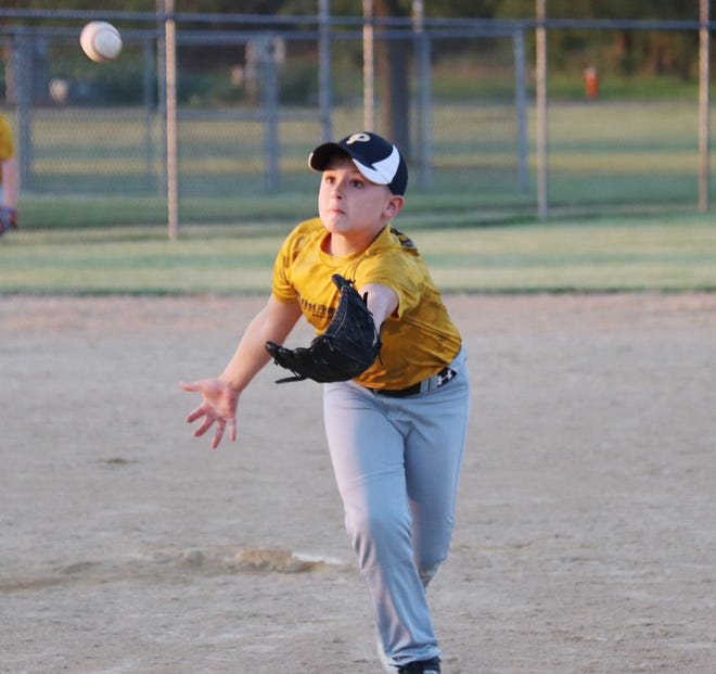 First Financial pitcher Henry Yedinak races to try to catch a blooper Wednesday evening at the Rec-Plex.