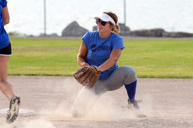 Katelyn Gabos and the Bomb Squad enjoyed a three-inning win over the Blaze earlier this week in women's softball league play.