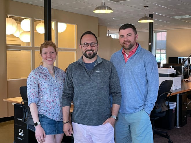 Chief officers at the ATOM Group include, from left,Alyssa Rosenzweig, associate partner; Jason Sgro, senior partner; and Matt Chepeleff, senior partner. ATOM, which is based on Jewell Court in Portsmouth, is expanding to Concord to create a newOffice for Public-Private Cooperation in Cybersecurity.