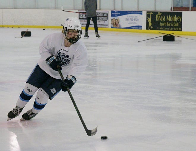 Zoë Puc maneuvers around the ice during practice drills at the Palm Beach Skate Zone. She's in training for the upcoming season.