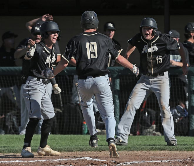 Evan Maloney scores on a two-run double by Wyatt Daft to give North Kingstown a 2-0 lead over Coventry in the first inning Thursday.