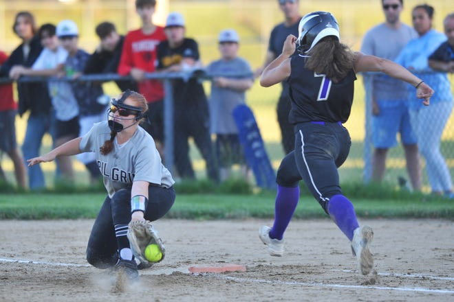 Pilgrim first baseman Kelsey Burr comes up with the scoop to get St. Raphael's Gemma D'Orazio by a step during Wednesday's game.