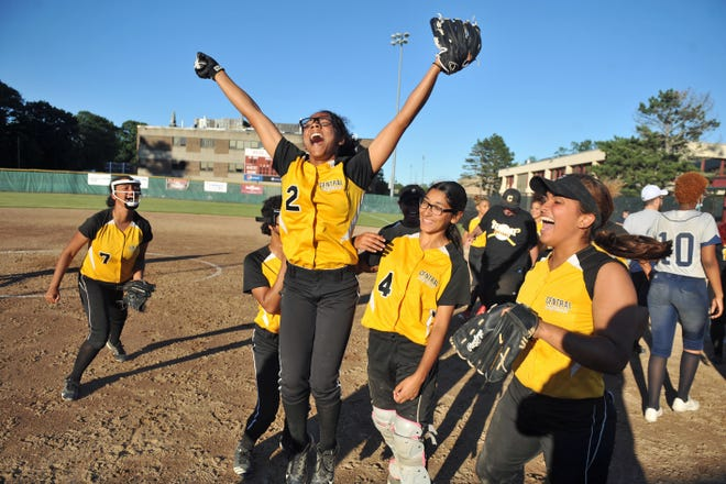 Nevaeh Robles-Rivera, jumping at center, and the Central softball team celebrate after defeating Shea/Tolman to win the Division IV softball title on Thursday.