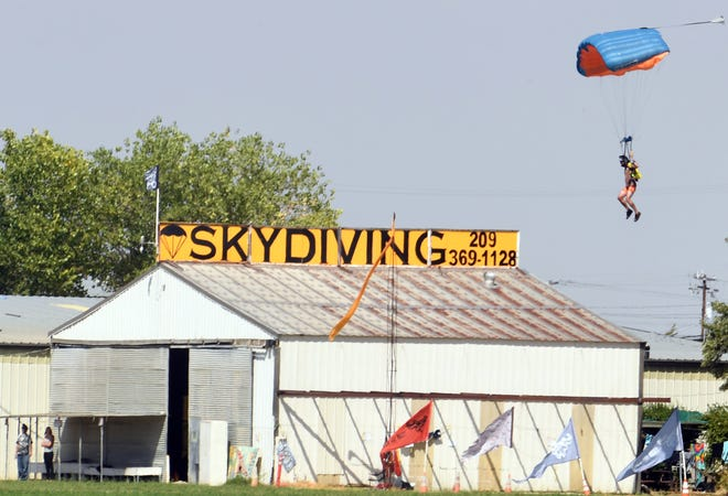 A parachutist  lands at Lodi Parachute Center shortly after another skydiver was injured in a jump on Sept. 14, 2017.