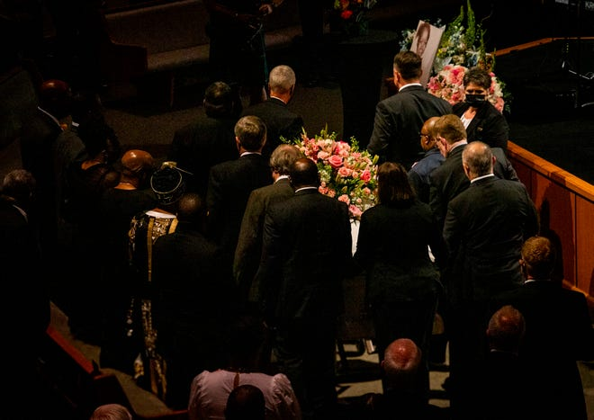 The bright white casket and lush floral arrangement shines between the pallbearers as they remove Lawanda Manning's casket at the end of the ceremony. Her pastor, friends, family, coworkers and community members were in attendance Wednesday afternoon, June 23, 2021.