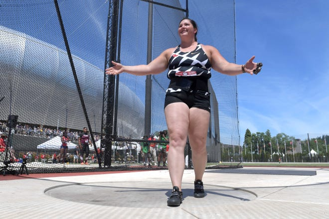 DeAnna Price celebrates her meet-record toss of 252-11 during Thursday's hammer qualifying at the U.S. Olympic Track & Field Trials at Hayward Field. Price was the 2019 world champion and has the best throw in the world this year with her American record of 257-10.