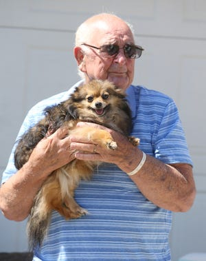 Ralph White with his dog Shania. He thought she was lost after a road rage attack but was later found by Canton Police.