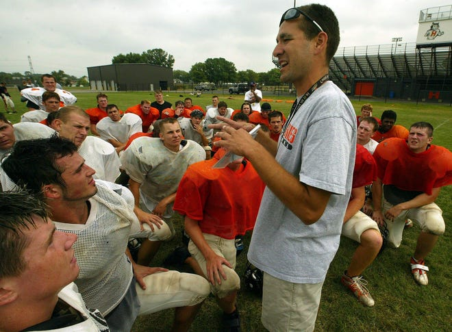 Jim Morrow, shown talking to Harlem players during practice, was hired to coach South Beloit's eight-man football team. Morrow was Harlem's head coach for 15 years and coached Belvidere last season.