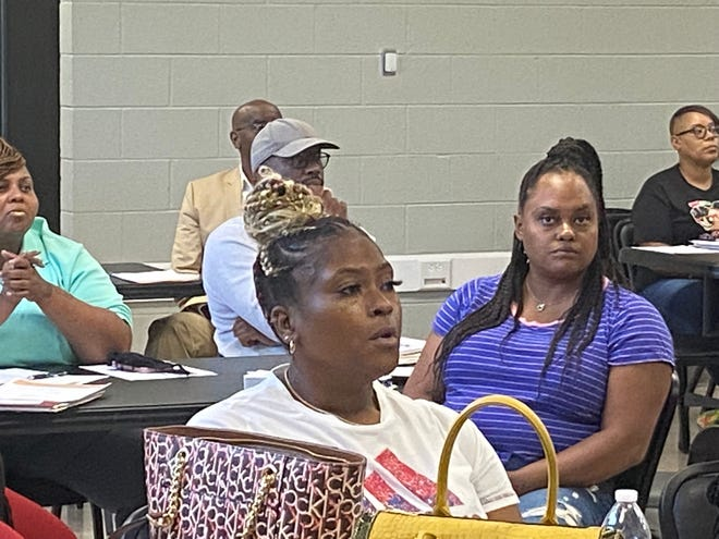 Maya Styles, owner of Too Sassy Accessories, listens to a presentation on how to set up a pop-up shop last week at the Charles Black Center in advance of a festival and small business expo that will be held at the center on July 17.