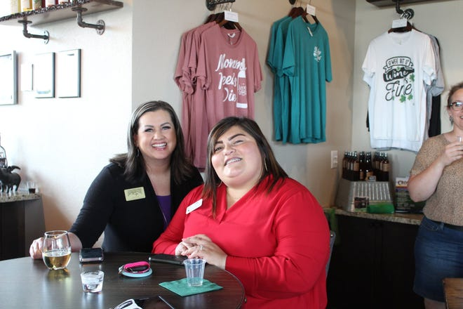 Julie Howell and Isabel Talamantes enjoy some wine and conversation during the May Chamber Mix hosted by Lucky Vines Vineyard and Winery.