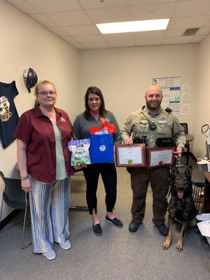 Representatives from Farmers Insurance came by the Erath County Sheriff's Office recently to congratulate Deputy Cody Allen and K9 Jax on a job well done.