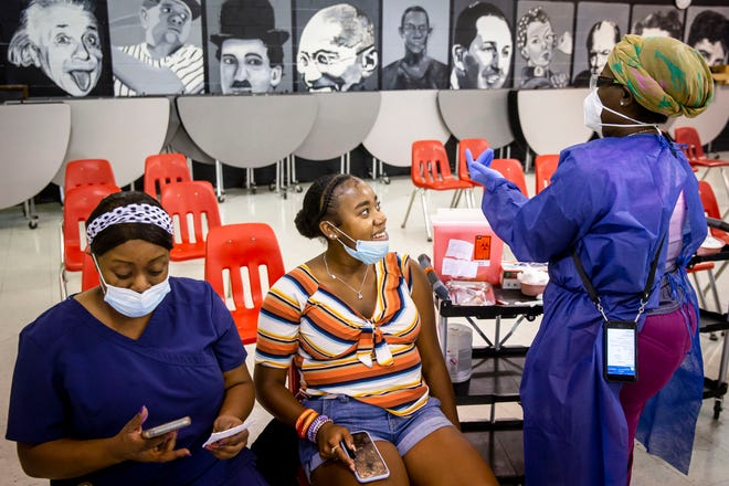 Ajailah Howze, 14, an incoming freshman at Springfield High School, gets ready to receive her second dose of the Pfizer COVID-19 vaccine during a clinic hosted by Springfield Public School District 186 at Springfield High School in Springfield, Ill., Thursday, June 24, 2021.