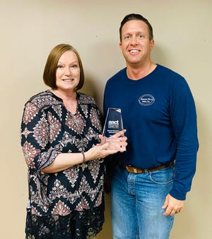 Shawnee Little Theatre Managing Director Rebecca Fry and President Craig Whitney display the Twink Lynch Award for advancing to higher levels of accomplishment, which the National Association of Community Theatres presented to SLT at the recent AACTFest virtual play festival.