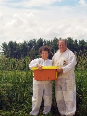 Sharon and Phil Raines prepare for new customers to pick up their bees. The Raines sell 100 to 150 nucs, or nucleus hives, to help new beekeepers get started.