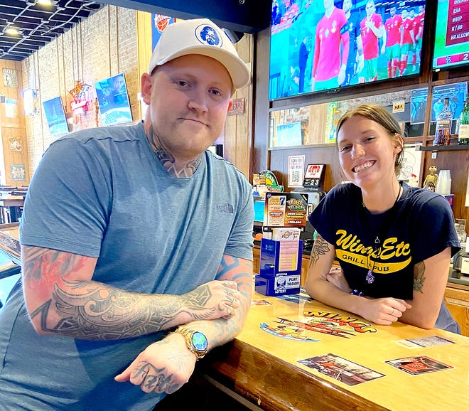 Patrick Sweet is a regular at Sturgis' wings establishmentsand is happy to be back out and about again. He is pictured here with Ali Burk of Wings Etc.