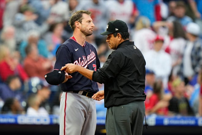 Washington Nationals' Max Scherzer reacts as he is being checked for foreign substances during a game against the Philadelphia Phillies.