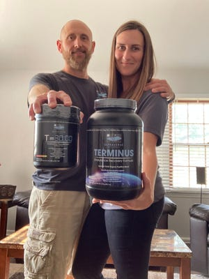 Chase and Casey Hammond hold containers of the dietary supplements offered by Ultraverse Supplements, a web-based business they officially started late last year.