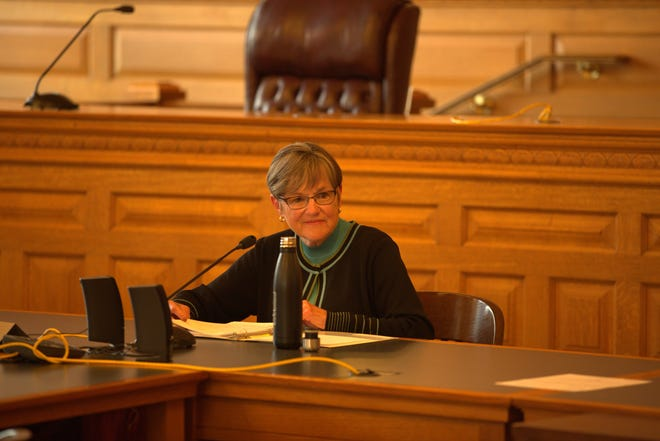 """Gov. Laura Kelly heads a meeting of the State Finance Council Thursday. The panel approved a settlement in the wrongful conviction case of Olin """"Pete"""" Coones."""