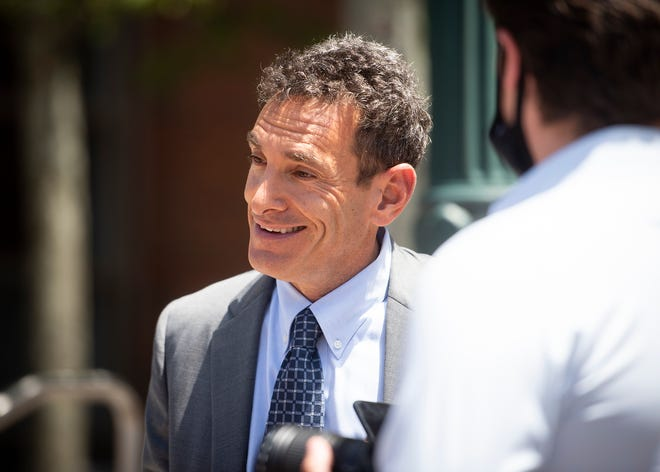 Attorney Blake Rubin smiles as he exits Worcester Superior Court after being found not guilty Thursday.