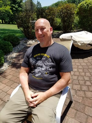 Matthew Indermill sits in the back yard of his Southside home in New Philadelphia four years after a drunken driver killed his wife Jeanene while they were riding a motorcycle. TIMES-REPORTER/NANCY MOLNAR