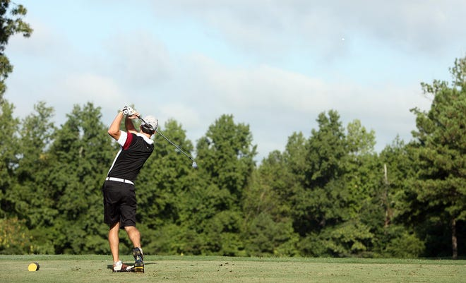 A golfer tees off on the fourth tee during the  Alabama Open golf tournament at Ol' Colony Golf Complex in  2012. [Staff file photo/Dusty Compton]