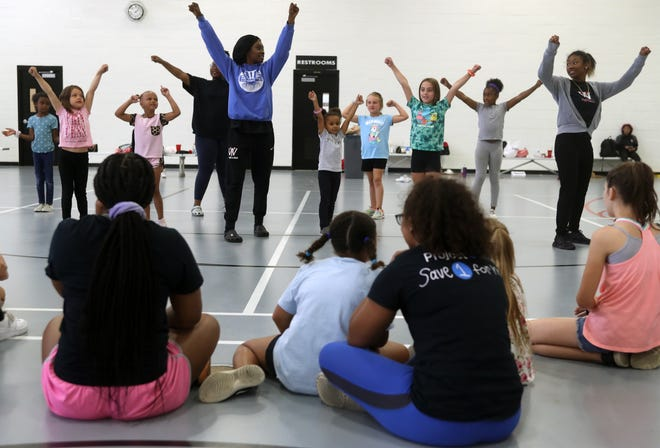 Whitehall-Yearling High School cheerleaders lead a group of campers in cheers and dance routines during a summer sports camp June 23 at the high school.