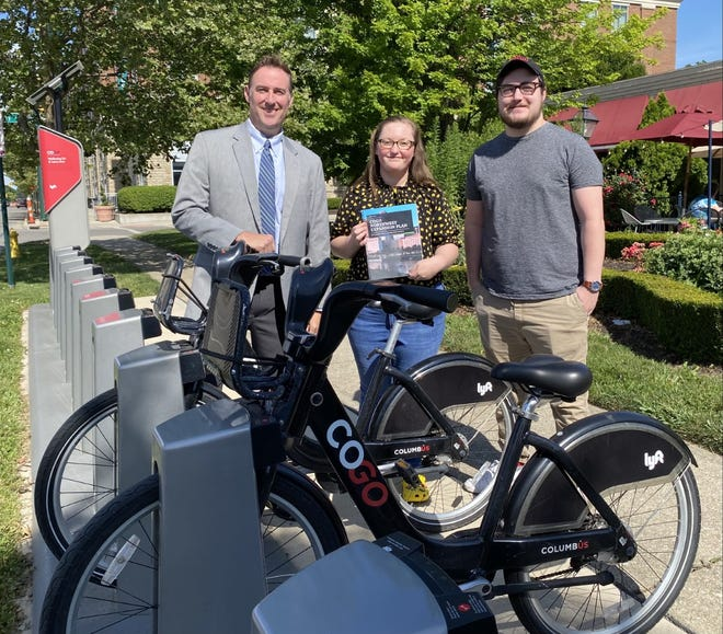 Chad Gibson (left), Upper Arlington community development director, stands with Samantha Lehr and Jacob Miller, students in his City Planning Studio class at Ohio State University. The class recently studied the CoGo Bike Share system in central Ohio and recommended adding 29 stations in Columbus, Dublin, Hilliard and Upper Arlington.