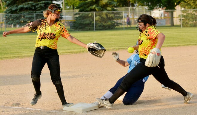 Watertown Wildfire third baseman Alayna Dettman (right) attempts to beat Watertown Devils base runner Madison Williams (hidden) to the bag during a fastpitch softball game recently at Koch Complex. At left is Wildfire shortstop Dashay Koch. The Wildfire are one of six Watertown teams set to play Friday through Sunday in the Watertown Fastpitch Softball Association's Premier Throwdown Tournament at Koch Complex and Foundation Fields.