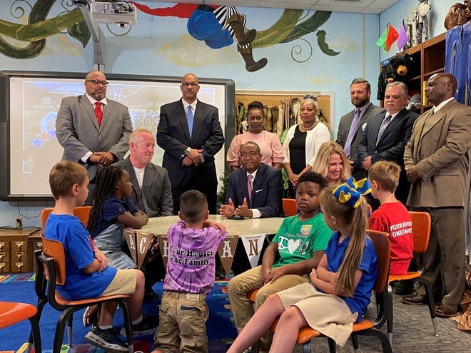 State Sen. Cleo Fields (center, at table) was in Alexandria on Wednesday to talk about mandatory kindergarten. He authored the bill that was signed into law on Monday by Gov. John Bel Edwards.