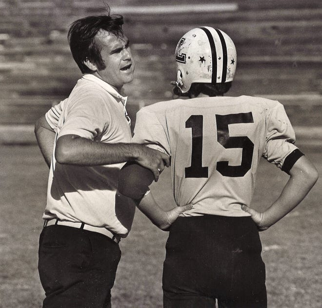 Lincoln Junior High coach Larry Coe talks with quarterback Bobby Mize during a game against Jefferson in October 1975. This was Coe's first season as head coach of the Longhorns.