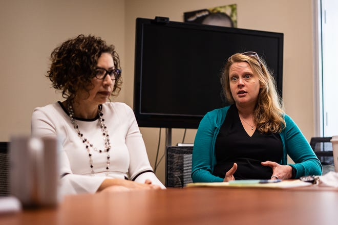 Laura Jeffords, right, executive director of The Mediation Center, speaks about upcoming budget cuts and how they could affect the center, which offers family visitation, mediation, youth conflict resolution and other related training services.