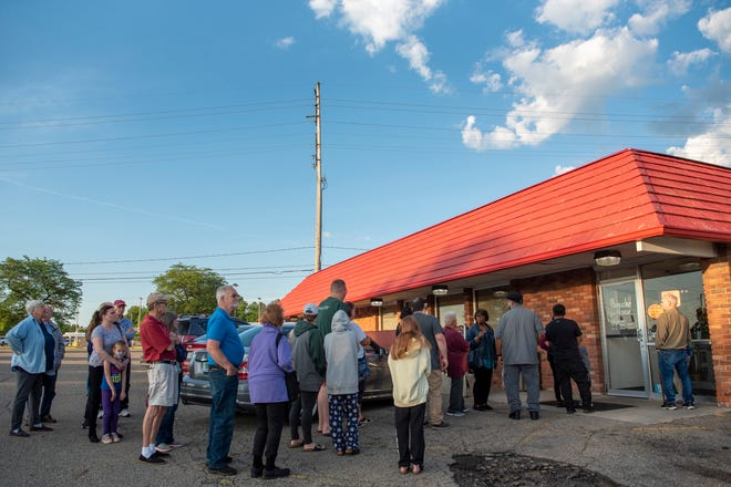Folks wait in line for the final day of the Pancake House on Thursday, June 24, 2021 in Battle Creek, Mich.