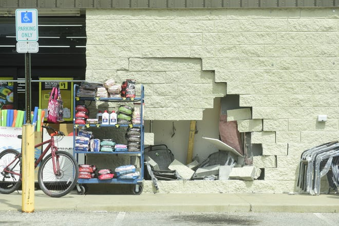 A hole remains in the wall of the Dollar General in New Washington after an 80-year-old woman wrecked into it Wednesday afternoon.