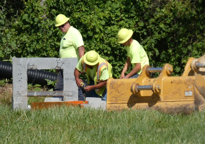 A crew from Dellinger Excavating continues work Tuesday on an access drive that will connect the Crawford County Sheriff's Office, 3613 Stetzer Road, with East Mansfield Street.