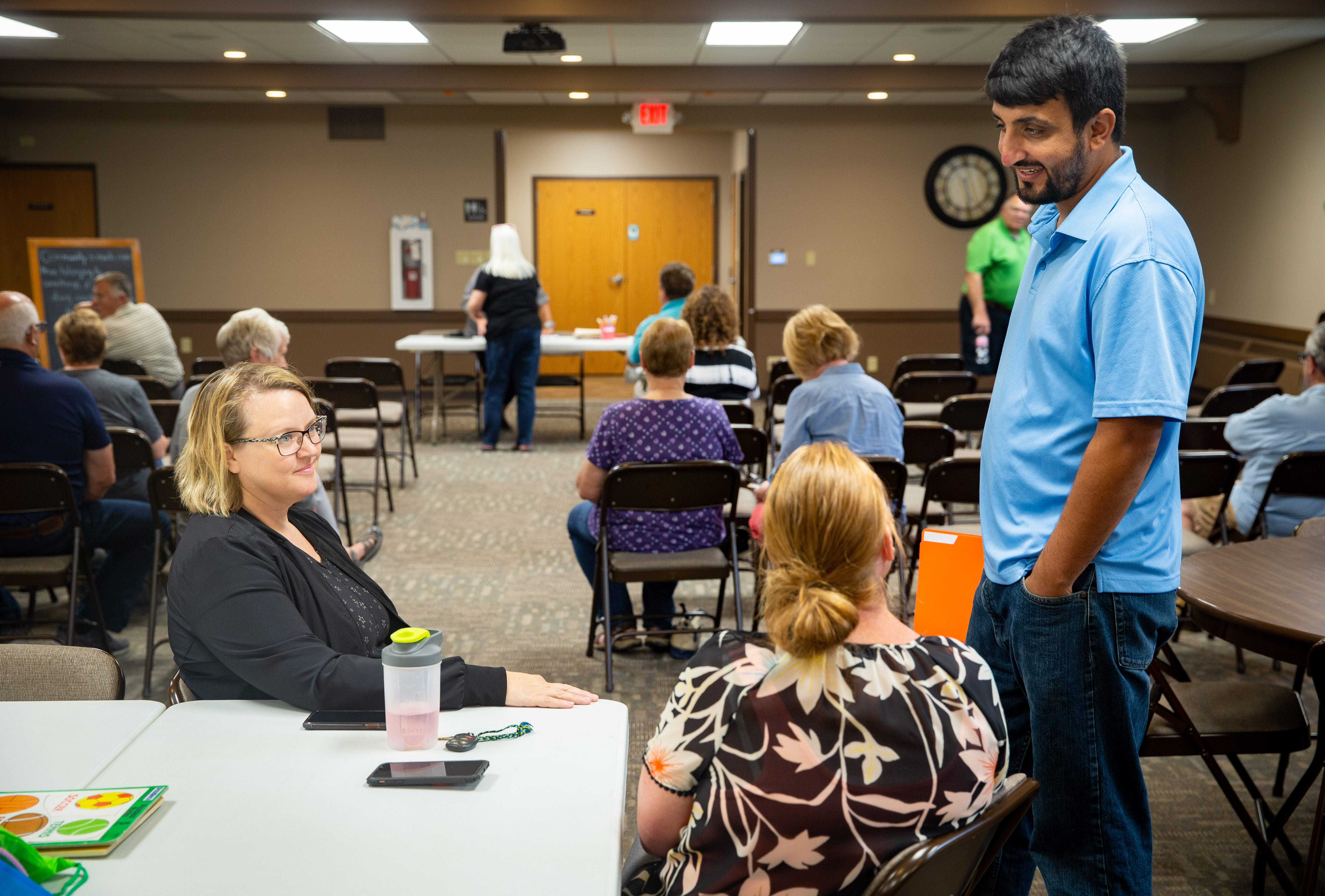 Zalmay Niazy chats with friends at the First United Methodist Church in Iowa Falls, Tuesday, June 22, 2021. Born and raised in Afghanistan, Niazy worked as a translator for U.S. armed forces.