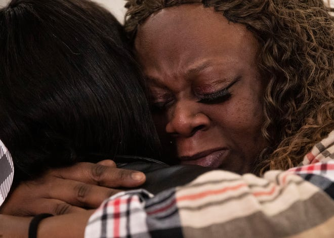 Keyana Dunlap hugs a friend at the funeral for her son, Keon Dunlap, January 9, 2021, in a church on the Eastside of Indianapolis. Dunlap was murdered at a gas station on the 3800 block of Emerson Ave in December 2020.