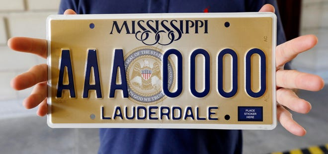 """Mississippi's standard license plate was unveiled in 2018 and released for use in 2019. It displays the state seal that includes the phrase, """"In God We Trust."""""""